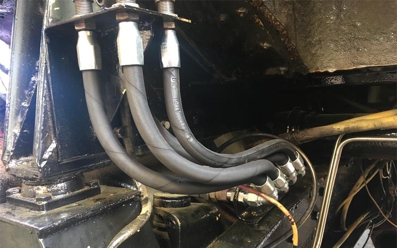 Close up of hydraulic hose repairs